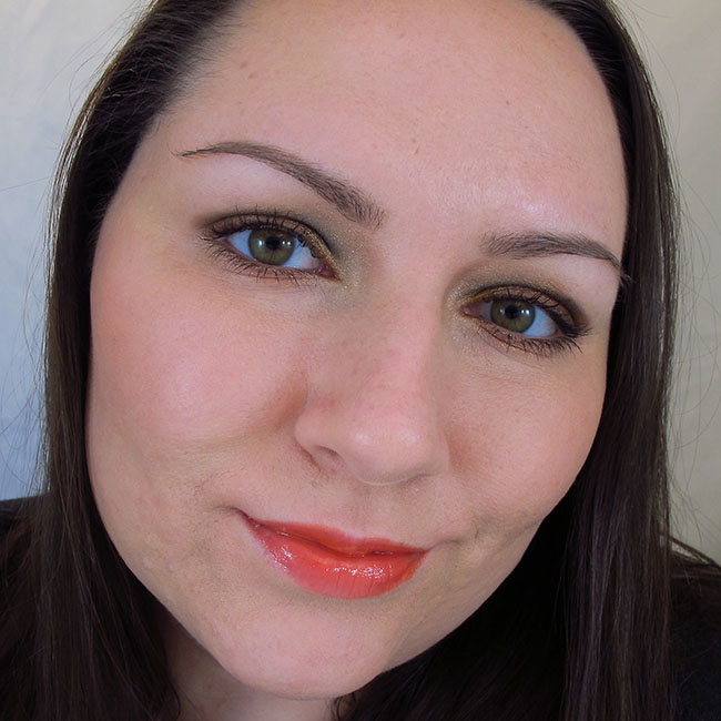Wearing Maybelline Color Sensational High Shine Gloss in Captivating Coral